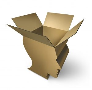 a box shaped like the profile of a human head has its flaps opened at the top