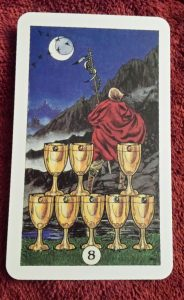 photo of the 8 of cups from the Robin Wood tarot deck