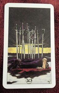 Photo of the 10 of Swords from the Robin Wood tarot