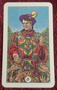 Photo of the Six of Pentacles from the Robin Wood tarot
