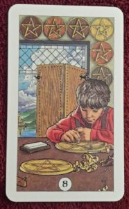 Photo of the Eight of Pentacles from the Robin Wood tarot deck