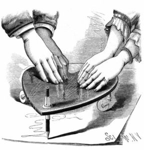 Line drawing of hands on a planchette