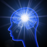 Stylized drawing of a blue outline of a person's head with a glowing blue brain